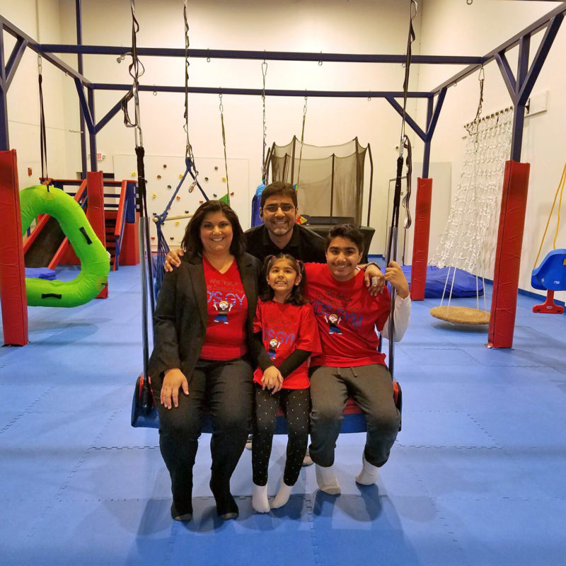 The Gulati Family on a sensory safe swing