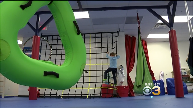 kid climbing rope wall - Autism toys