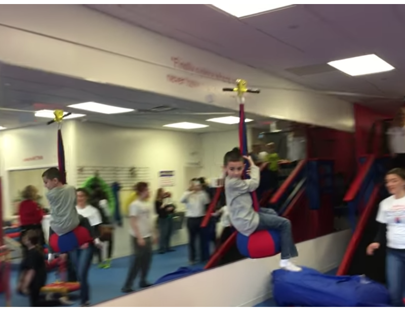 kid riding zip line in sensory gym staten island new york