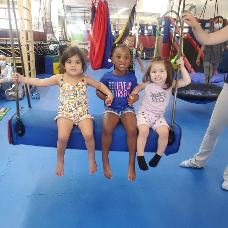 WRTS Tarzana Kids Sitting On Bolster Swing